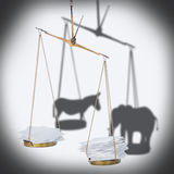 8 november USA election concept of ballot scale with heap paper. Blanks and shadow donkey, elephant like metaphor, close up royalty free stock image