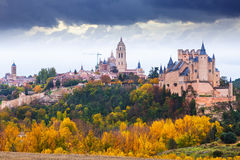 November view of Segovia. With Alcazar and Cathedral in cloudy day. Spain stock image