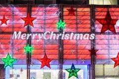 13. November 2014 Zeichen der frohen Weihnachten auf Stiefelshop Oxford-St. Stockfotografie