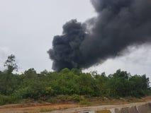 27 novembre 2016, Johor Fumée brûlante près de route Photos libres de droits