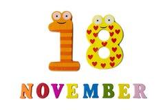 18 novembre su fondo, sui numeri e sulle lettere bianchi Fotografia Stock