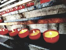 Novena candles Stock Images