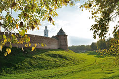 Novgorod Kremlin fortress on the hill among the yellowed trees in sunny autumn evening Royalty Free Stock Photo