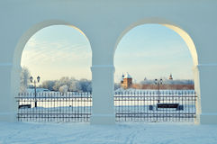 Novgorod Kremlin in Veliky Novgorod, Russia - winter sunset framed view. Novgorod Kremlin fortress framed by the arches of Yaroslav Courtyard ancient trades in Stock Photography