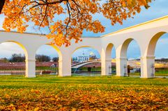 Novgorod Kremlin and Yaroslav Courtyard arch, Veliky Novgorod, Russia. Autumn sunset view. VELIKY NOVGOROD, RUSSIA -OCTOBER 19, 2017. Novgorod Kremlin and Royalty Free Stock Photography