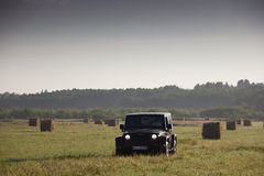 Novgorod region, Russia, August 15, 2014: Journey to the Jivas Wrangler unlimited Sahara for Novgorod region. Wrangler is a compac. Journey on a Jeep Wrangler in Stock Photos