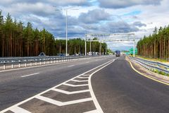 Toll road. Russian highway number M11 in summer day Stock Photos