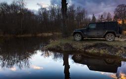 Novgorod region, Russian Luga River, Russia, April 10, 2016 , travel by Jeep Wrangler Stock Photography