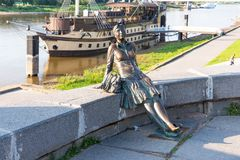 Novgorod, Russia - August 31, 2018: Sculpture of tired tourist girl on the background of the river. Girl-Tourist Monument. Photo stop in Veliky Novgorod royalty free stock image