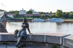Novgorod, Russia - August 31, 2018: Sculpture of tired tourist girl on the background of the river. Girl-Tourist Monument. Photo stop in Veliky Novgorod stock images