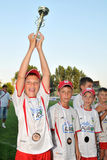 Novi grad - Tuzla youth soccer game. KAPOSVAR, HUNGARY - JULY 24: Unidentified players celebrate after the VI. Youth Football Festival Under 12 Final FK Novi Royalty Free Stock Photos