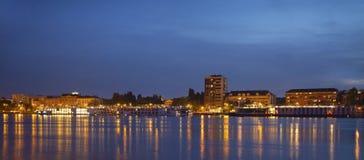 Novi Sad Quay at Night. Panorama of Novi Sad quay at night with many ships docked Stock Photos
