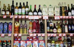 Novi Sad, Serbia, 06.02.2018 alcoholic beverages on the shelf. Novi Sad, Serbia, 06.02.2018 alcoholic beverages and soft drinks on the shelf with prices royalty free stock photos