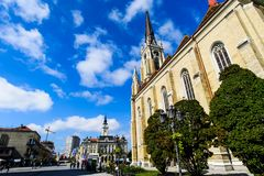 Novi Sad, Serbia - August 15, 2018: Novi Sad cathedral and pedestrian walking area view at central city square on a sunny day stock photo