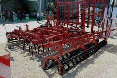 Novi Sad, Serbia, 20.05.2018 Fair, Kverneland Vibro Cultivator. Red and black color, Cultivator, farm implement or machine designed to stir the soil around a Stock Image