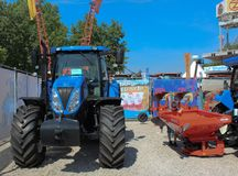 Novi Sad, Serbia, 20.05.2018 Fair, Tractor and Fertilizer Spreaders. Novi Sad, Serbia, 20.05.2018 Fair, Tractor New Holland with Kuhn Fertilizer Spreaders Royalty Free Stock Photos