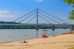 Free Novi Sad, Serbia - July 3, 2019: People Enjoy On A Beach On A Danube River, View At Liberty Bridge In Novi Sad, Serbia Stock Photography - 155332742
