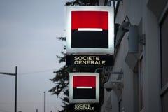 NOVI SAD, SERBIA - MARCH 11, 2017: Logo of the Societe Generale Srbija Bank illuminated in the evening on a branch Novi Sad, Serbi Royalty Free Stock Image