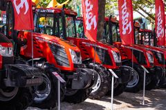 Modern tractors and harvester on display on Agricultural fair. Novi Sad, Serbia: may 9. 2015 - Novi Sad Agro fair with people and Fair show. Modern tractors and Stock Photography
