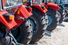 Modern tractors and harvester on display on Agricultural fair. Novi Sad, Serbia: may 9. 2015 - Novi Sad Agro fair with people and Fair show. Modern tractors and Royalty Free Stock Images