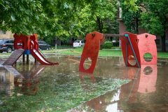 Submerged children playground after a storm Royalty Free Stock Photography