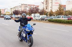 Novi Sad, Serbia. October - 19. 2018. Young man biker driving Yamaha R6 YZF motorcycle on the street and showing thumbs up with hi stock photography