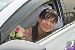 Novia en coche Imágenes de archivo libres de regalías