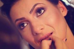 Novia en estudio del maquillaje Imagen de archivo libre de regalías