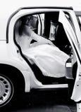 Novia en una limusina Imágenes de archivo libres de regalías