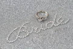 Novia y anillo en el fondo de plata Imágenes de archivo libres de regalías