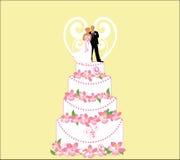 Novia y novio en la torta de boda Foto de archivo libre de regalías