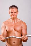 Novice bodybuilder training Royalty Free Stock Images