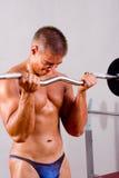 Novice bodybuilder training. His bicep stock photo
