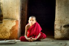 Novice buddhist monk in Bagan stock photography
