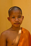 A novice Buddhist monk of a riverside temple in Kampot, Cambodia Royalty Free Stock Images