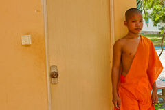 A novice Buddhist monk of a riverside temple in Kampot, Cambodia Stock Photos
