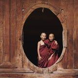 Novice Buddhist Monks at Shwe Yan Pyay Monastery, Nyaung Shwe, Myanmar. Novice Buddhist monks smiling at Shwe Yan Pyay Monastery in Nyaung Shwe village, near stock photography