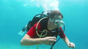 Novice diver learns to swim with scuba diving stock video