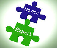 Novice Expert Puzzle Shows Unskilled And Professional Royalty Free Stock Photography