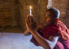 Novice monk in bagan Myanmar. BAGAN , MYANMAR - SEP 05 2017: Novice monk in bagan Myanmar on September 05 2017 , The ruins of Bagan has 2,200 temples and pagodas stock photo