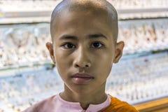 Novice monk in famous Shwe Yan Pyay Monastery school. NYAUNG SHWE, SHAN STATE, MYANMAR - AUG 13, 2015: portrait of Novice monk in famous Shwe Yan Pyay Monastery royalty free stock photos