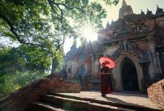 Novice monk in front of Sulamani Pagodas. Bagan. BAGAN, MYANMAR - DEC 13, 2015: novice monk in front of Sulamani Pagodas. Bagan on December 13, 2015 in Bagan royalty free stock photos