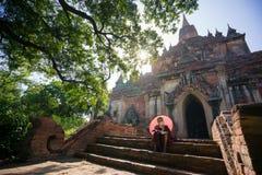 Novice monk in front of Sulamani Pagodas. Bagan. BAGAN, MYANMAR - DEC 13, 2015: novice monk in front of Sulamani Pagodas. Bagan on December 13, 2015 in Bagan stock images