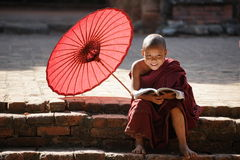 Novice monk in front of Sulamani Pagodas. Bagan. BAGAN, MYANMAR - DEC 13, 2015: novice monk in front of Sulamani Pagodas. Bagan on December 13, 2015 in Bagan stock photos