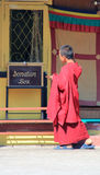 Novice monk looking at the donation box Royalty Free Stock Images
