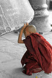 Novice monk looking under Mingun Bell Royalty Free Stock Images