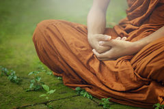 Novice monk meditating. The concept of meditation royalty free stock photography