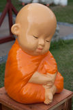 Novice monk statue. Made of Mortar Pasteur royalty free stock image