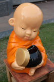 Novice monk statue. Made of Mortar Pasteur stock photography