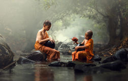 Novice Monk in Thailand. Asia stock photo